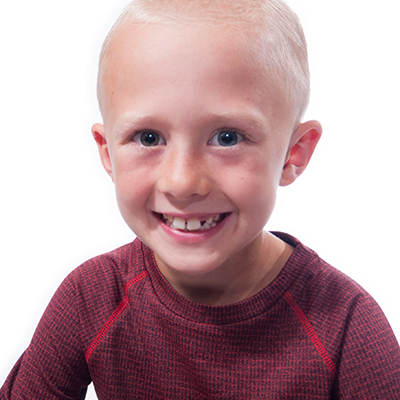 Happy young man with a Great Grin - Early Orthodontics at Great Grins for KIDS in Portland, OR