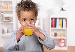 Kid drinking Juice after expanding palate by Oregon City Pediatric Dentist at Great Grins for KIDS - Portland.
