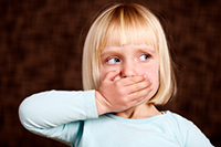 A girl covering her mouth